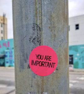 Red circular sticker which says on it - You are important