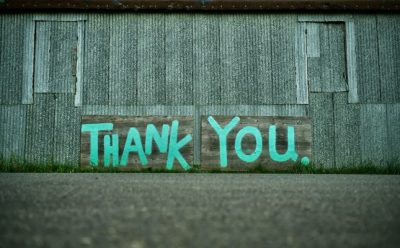 Grafitti wall with words in green capitals THANK YOU